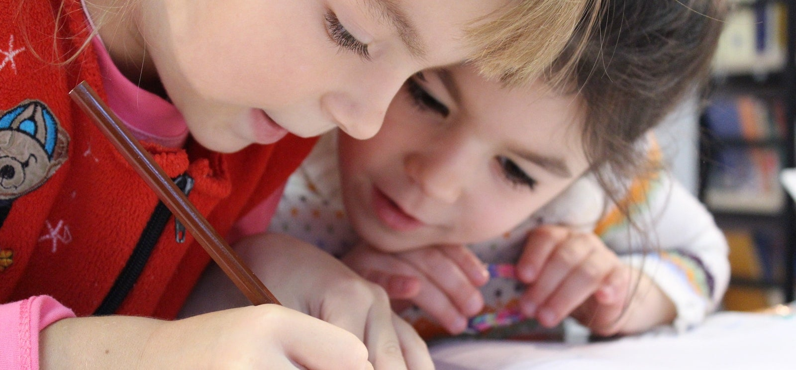 Two cute children focused on their drawing
